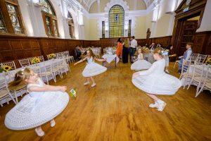 flowergirls dancing by glasgow wedding photographer Ian Arthur