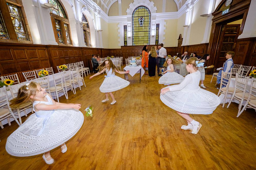 flowergirls dancing by glasgow wedding photographer Ian Arthur
