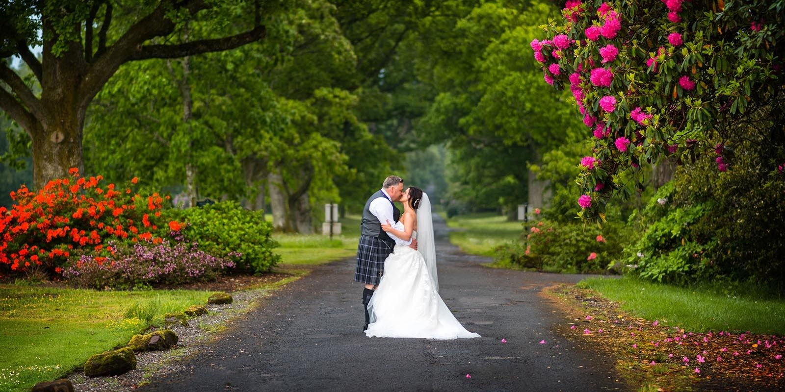 Stolen kisses and natural moments captured by Glasgow wedding Photographer Ian Arthur